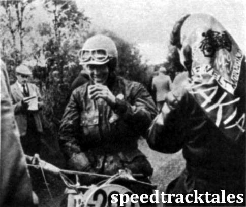 Photo - Swedish moto-cross star Rolf Tibblin enjoys a warm drink while waiting at the St. Hermon check on Tuesday. ISDT 1961