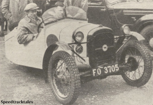 Photo - CB Lloyd and his interesting home-built Heywood 'three-wheeler' [FO 3705] consisting largely of Austin 7. It has twin rear wheels with the driving shaft between them - ISDT 1938 (image courtesy Morton Media)