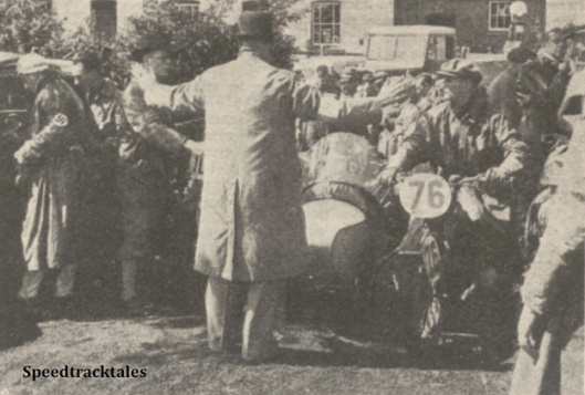 Photo - Not a community song leader, but the marshal at the lunch check trying to hold back the crowd of competitors storming the control. The rider in front is the German #76 L Kraus (BMW Sc) - ISDT 1938 (image courtesy Morton Media)
