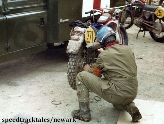Photo - Gold medal winner #271 Z Cespiva of Czechoslovakia prepares to drop the rear wheel for a tyre change ISDT 1971 (Newark Collection)