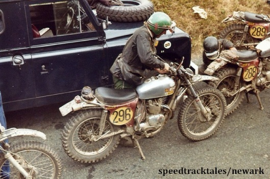 Photo - Gold medal winner #296 Mick Andrews and the bikes of #288 Malcolm Rathmell who fettles on his bike and #289 Arthur Browning  ISDT 1971 (Newark Collection)