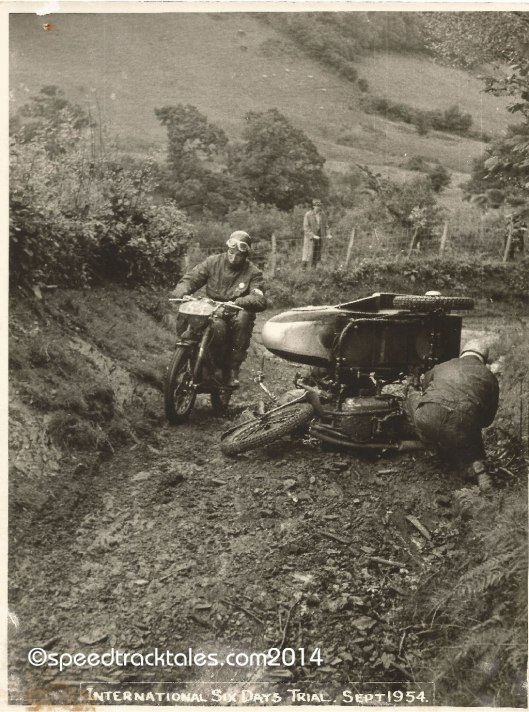 Photo - #50 WT Howard on the works entered BSA 350cc Sidecar outfit indulges in on track maintenance ISDT 1954 - (speedtracktales collection)