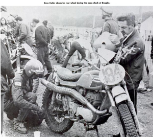 image - #184 Dave Cutler Ossa, of the USA cleans his rear wheel during the noon check at Douglas ISDT 1971
