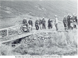 image - Dave Latham of the USA stops on a bridge to size up his way across a bog on the lower slops of Snaefell that eliminated many riders ISDT 1971