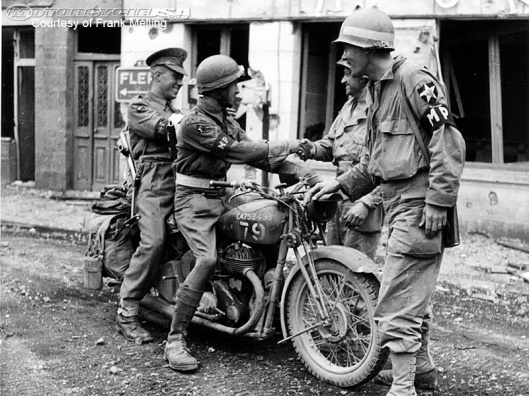 Photo - British soldier and MP on motorbike greeting American Soldiers WW2