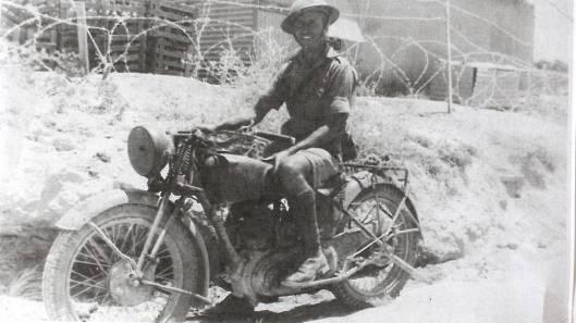 Photo - Dispatch Rider Bob Anson in Syria 1942 on 1939 Norton. (Newcastle Herald)
