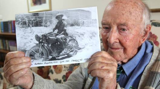 Photo - Bob Anson as a Dispatch Rider in Syria in 1952 on a 1939 Norton. (Newcastle Herald)