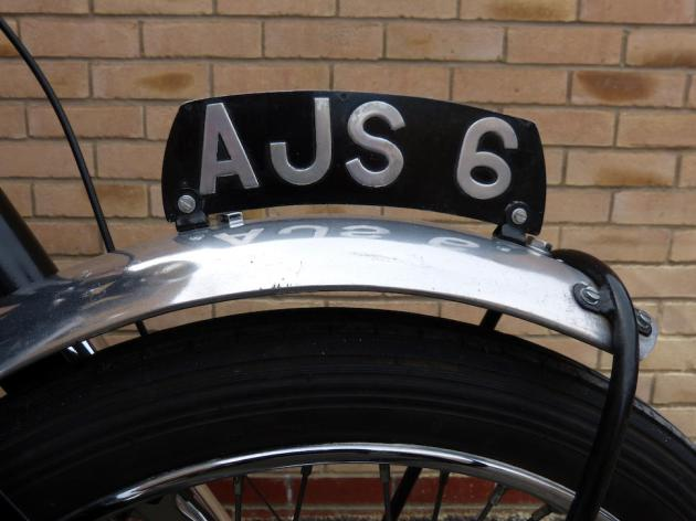 Photo - Detail of Number plate [AJS 6] Works AJS 498 of Hugh Viney ISDT 1953 (Courtesy Bonhams)